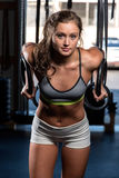 Color  image of an athletic woman in a gym working out Royalty Free Stock Photography