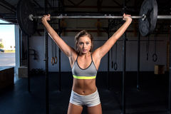 Color  image of an athletic woman in a gym working out Royalty Free Stock Photos