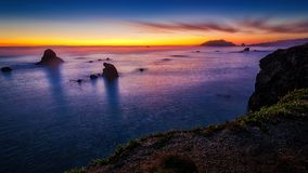 Sunset at a Rocky Northern California Beack. Color image of a beautiful sunset overlooking the Pacific Ocean in Northern California Stock Photos