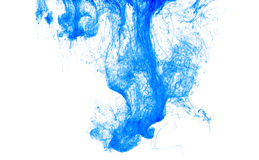 Color ink drop in water, photographed in motion, swirling. Blue icloud of paint on white background. Stock Image