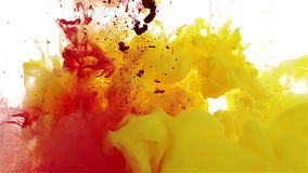 Color ink drop in water. yellow, red, violet falling. Colors dropped into liquid, photographed n in motion. Ink swirling in water. Cloud of silky ink in liquid stock video footage