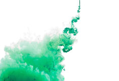 Color ink paint in water, photographed motion, isolated on white. Stock Photo