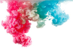 Color ink paint in water, photographed motion, isolated on white. Stock Image