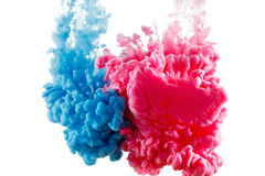 Color ink paint in water, photographed motion, isolated on white. Color Ink in water, photographed in motion. Swirling paint drop watercolor. Cloud isolated on stock image