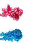 Color ink paint in water, photographed motion, isolated on white. Royalty Free Stock Images