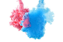 Color ink paint in water, photographed motion, isolated on white. Royalty Free Stock Photography