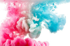 Color ink paint in water, photographed motion, isolated on white. Stock Photos