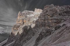 Color isolation effect of dolomitic rocky pinnacles in front of Tofana di Rozes southern wall. Cortina d`Ampezzo, Italy royalty free stock image