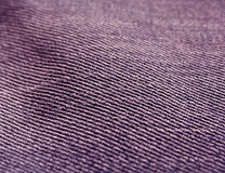 Color jeans textile texture close-up with blur effect. Stock Image