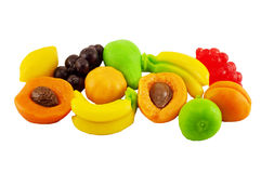 Color jellys in the form of fruit. Colored jelly candies in the shape of fruits banana pear grapes peach apricot lemon isolated on a white background Royalty Free Stock Image