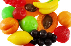 Color jellys in the form of fruit. Colored jelly candies in the shape of fruits banana pear grapes peach apricot lemon isolated on a white background Stock Photography