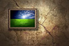 Color landscape on grunge wall. Color landscape on the old grunge wall royalty free stock photo