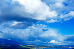 Color landscape with storm clouds, green and Royalty Free Stock Image