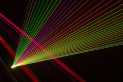 Color laser beams. Fantail in a haze Stock Photo