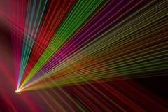 Color laser beams. Fantail in a haze royalty free stock photos