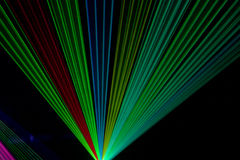 Color laser beams. Fantail in a haze Royalty Free Stock Image