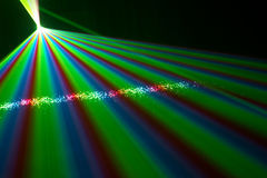 Color laser beams. Fantail in a haze Royalty Free Stock Photography