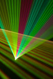 Color laser beams. Fantail in a haze royalty free stock images