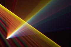 Color laser beams. Fantail in a haze Stock Photos