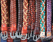 Color leather belts. A lot of leather belts in store Stock Image