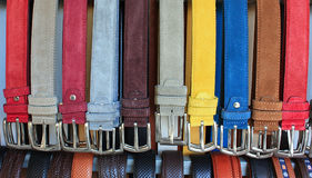 Color leather belts. A lot of leather belts in store stock images
