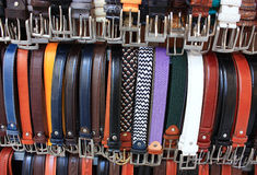 Color leather belts. A lot of leather belts in store Stock Photos