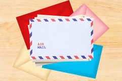 Color letters envelopes over wooden texture Stock Photo