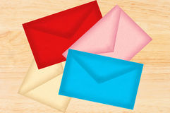 Color letters envelopes over wooden texture Royalty Free Stock Image