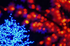 Color light blurred bokeh on black background, defocused. Background and pattern decorations. Red and green stock photography