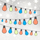 Color light bulbs on gray bokeh background Royalty Free Stock Photos