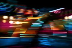 Color lights on the move. Colorful lights of urban city surrounding moving and blurred by motion stock photography