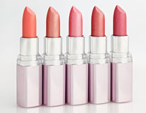 Color lipsticks arranged in line isolated on white Stock Photography