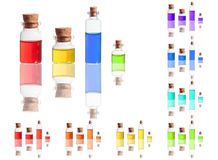 color liquid in bottles with cork isolated on white Royalty Free Stock Photo
