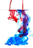 Color liquid in water. Blue and red ink in water abstract Stock Photos
