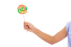 Color lollipop in child hand Royalty Free Stock Photography