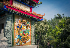 Color low relief of god warrior in Sik Sik Yuen Wong Tai Sin Temple at Hong Kong. Stock Photography