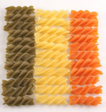 Color macaroni. Multi-coloured macaroni of spiral is lied out with numbers royalty free stock photography