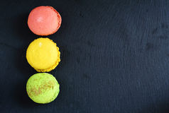 Color macaroon on slate background Stock Images