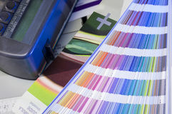 Color management in printing process with color swatches and densitometer Royalty Free Stock Images