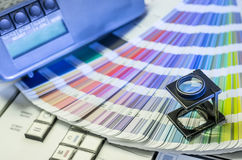 Color management in printing process with magnifying glass royalty free stock photos