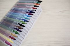 Color Marker Pens in plastic box on wooden table background. Water color Marker Pens in plastic box on wooden table background with space for text stock photos