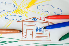 Color markers on child's drawing Royalty Free Stock Images