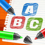 Color markers and letters on paper sheet Stock Image