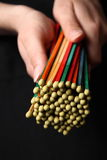 Color match. A bundle of colored matches in woman's hands Royalty Free Stock Photos