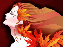 Color me Orange-Autumn Girl. Orange is synonymous with autumn. Featuring a Beautiful autumn girl with falling autumn leves in different shades of orange color Stock Photo