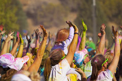 Color Me Rad Hands. Color Me Rad, colorful crowd of hands and people from Color Bombs. Charity 5k run stock image