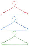 Color metal hangers isolated Royalty Free Stock Photos