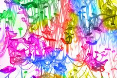 Color Mix. A background of different colors dissolving in a water with white background stock image