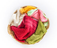 Color mix towel in wicker baskets on white background , top ab. Close up color mix towel in wicker baskets on white background , top above or overhead view royalty free stock photography