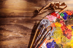 Color mixing palette with brushes and mannequin. Mixing palette with brushes and mannequin Royalty Free Stock Photo